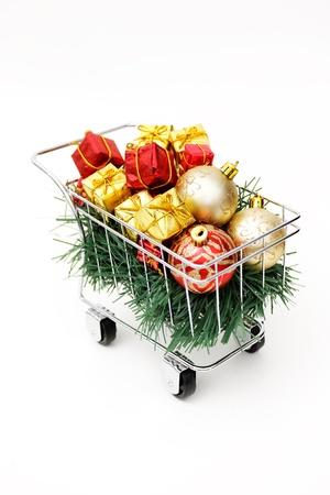 Christmas shopping cart on white background Stock Photo - 18581990