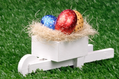 pushcart: Photo of Colored Easter Eggs and Pushcart Stock Photo