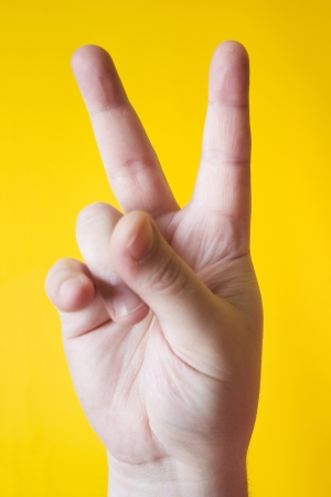 fingerspelling: Photo of Hand Signal - VictoryLove Stock Photo