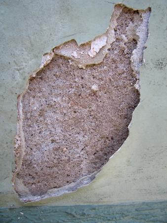 flaky: Photo of Damaged wall