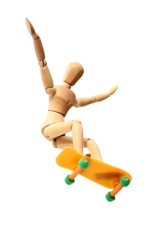 Dummy skate jump on white background photo