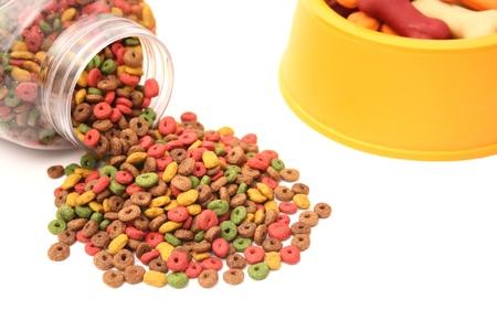 A spread dog food and a bowl on a white background. Stock Photo - 18601446