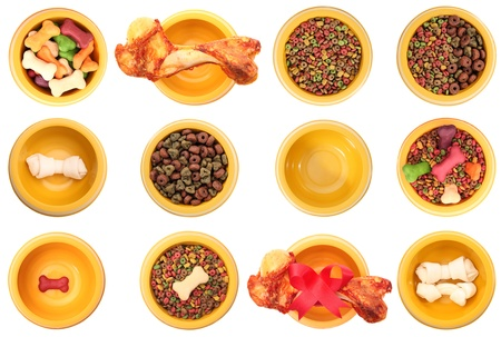 dog bone: An isolated dog bowls with different dog foods on a white background. Stock Photo