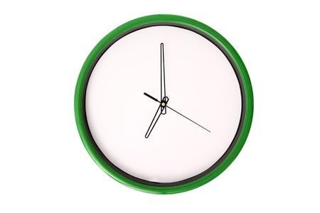 o�??clock: Un reloj que muestra las 7. Aislado en un fondo blanco. Foto de archivo