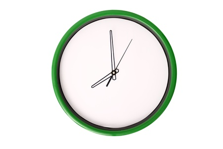 seven o'clock: A clock showing 8 oclock. Isolated on a white background. Stock Photo