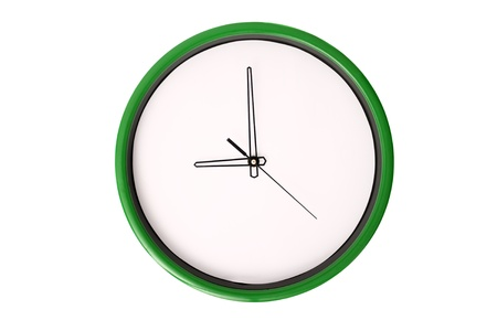 oclock: A clock showing 9 oclock. Isolated on a white background.