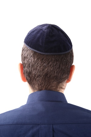 A kippah is a small cap (head covering), is a thin, slightly-rounded skullcap traditionally worn by observant Jewish men. photo