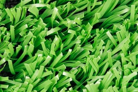pasto sintetico: Foto de cerca de la hierba sintética (textura)