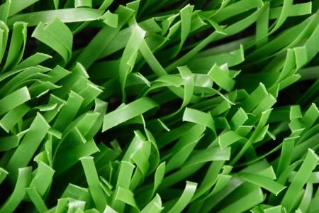 pasto sintetico: Foto de c�sped sint�tico de primer plano (textura) Foto de archivo