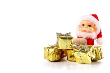 Photo of Santa Claus and  gifts photo