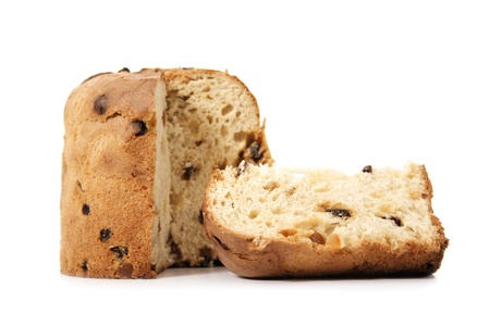 A panettone and slice on a white background.