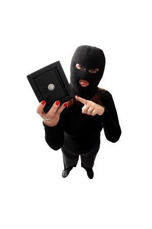 shoplifter: Thief holding a safe isolated on white background