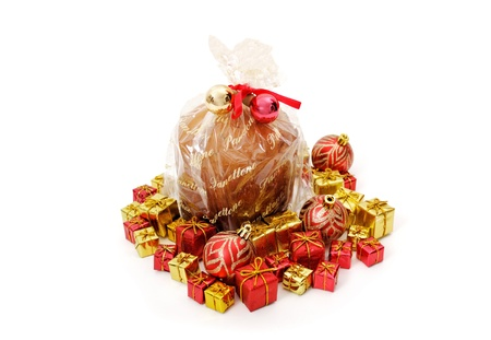 Isolated panettone and ornaments isolated on white background photo