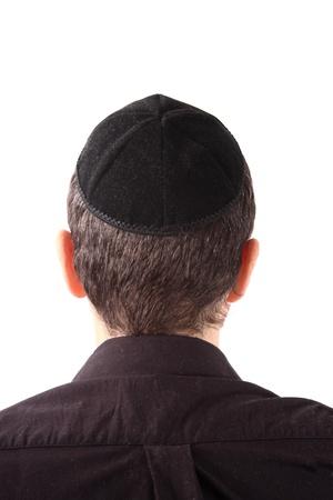 israelite: Rear view of a man wearing a Kippah on white background