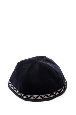 kippah: A kippah is a small cap (head covering), is a thin, slightly-rounded skullcap traditionally worn by observant Jewish men. Stock Photo