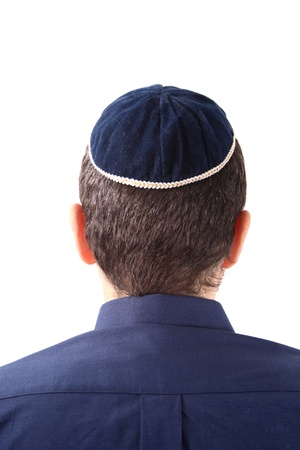 Rear view of a man wearing a Kippah on white background photo
