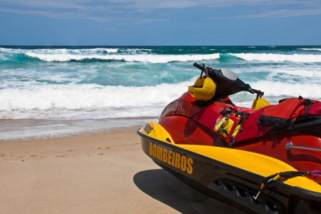 watercraft: Brazilian firefighter aquatic motorbike  watercraft  on the beach for rescuing people  Stock Photo