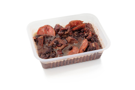 frozen food: Brazilian Feijoada in a package for frozen food or to go  Package on a white background  Stock Photo
