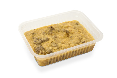 Beef Stroganoff package for freezing or to go on brown leather background  photo