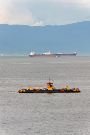 ferryboat: Ferryboat crossing the ocean - Ilhabela - Brazil Stock Photo