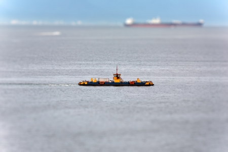 ferryboat: Bokeh image of a Ferryboat crossing the ocean - Ilhabela - Brazil Stock Photo