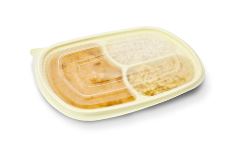 Closed  package of chicken stroganoff package for freezing or to go on white background  photo
