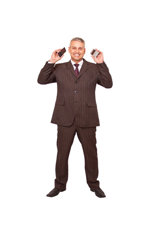 A brazilian business man busy on callings isolated on white background. photo