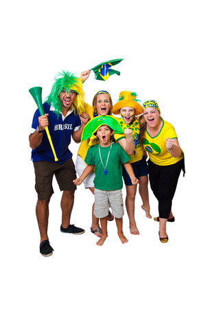 Brazilian family celebrating a Brazilian soccer team goal on white background