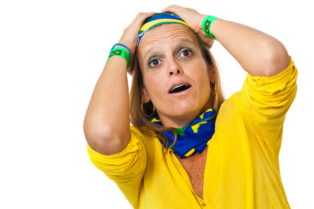 missed: Brazilian supporter suffering for missed goal chance on white background Stock Photo