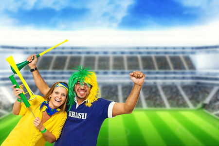 Brazilian couple supporters at stadium celebrating a brazil team goal photo