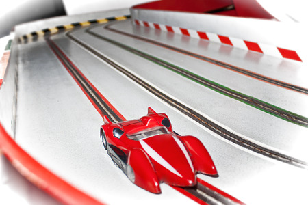 slot car track: Eletric slot car on a racetrack - Car modeling memories Stock Photo