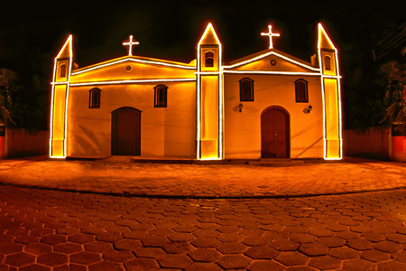 Antique chapel in Ilhabela, Brazil at night. photo