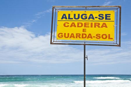 umbrela: Rent sign for beach chair and beach umbrela. Stock Photo