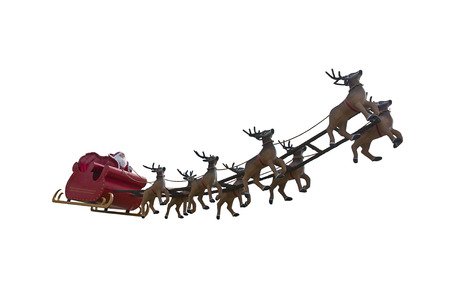 Santa Claus riding a sleigh led by reindeers isolated on white background Stock Photo
