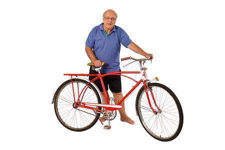 70 80: Brazilian senior riding an antique bike isolated on white background