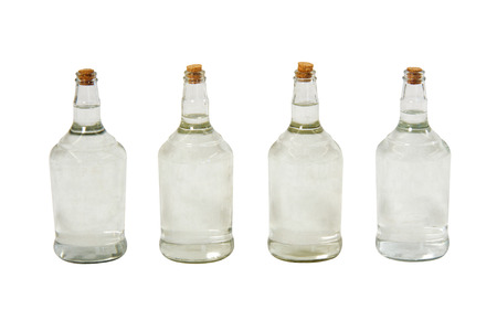distillate: Brazilian cachaca bottles isolated on white background with path.