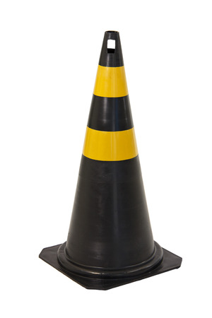 Black and yellow traffic cone isolated on white background photo