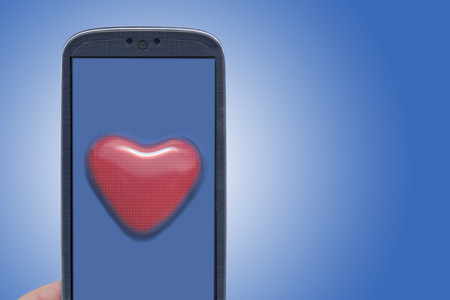Blue smartphone and blister heart shape. Idea for Valentines Day messages, love, lovers, love apps, Internet, blogs and others. photo