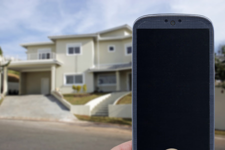 Smatrphone and house. Idea for smartphone home security system monitoring system real state applications contractor architecture house improvements  and others.