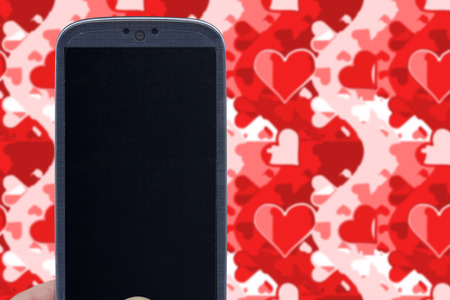 Blue smartphone and love wallpaper. Idea for Valentines Day love messages lovers love apps Internet blogs and others. photo