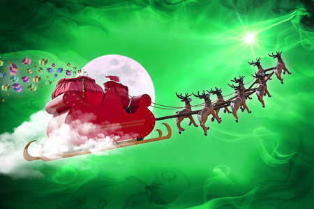 rudolph: Santa Claus riding a sleigh led by reindeers delivering gifts Stock Photo