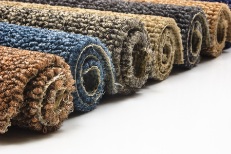 carpet and flooring: Colorful carpet rolls on white background Stock Photo