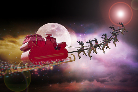 Santa Claus riding a sleigh led by reindeers following the star