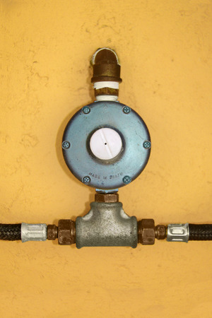 LGP gas regulator installed on wall with connections Stock Photo