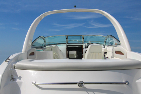 motorboat: Back view of a white motorboat