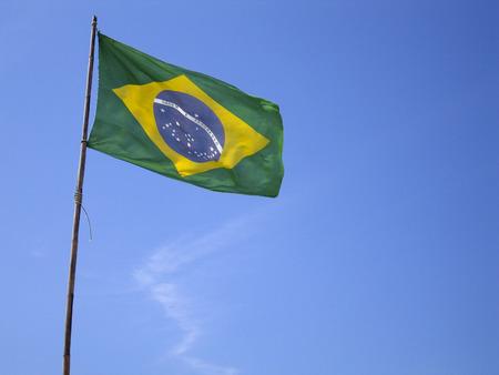 flagging: Brazilian flag on blue sky - View from bottom