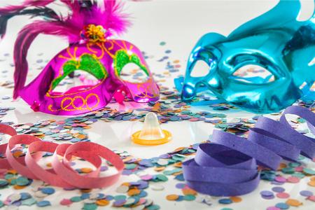 contraceptive: Carnival protection love theme - Condom contraceptive rubber Stock Photo