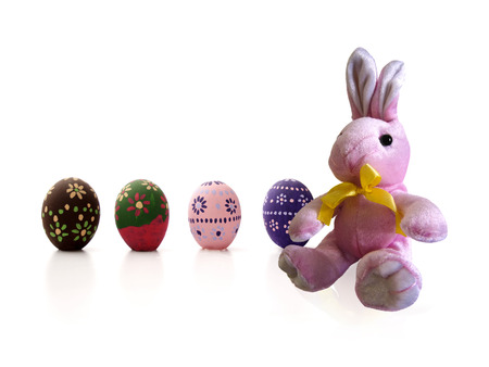 painted eggs: Sat pink Easter Bunny and painted eggs Stock Photo