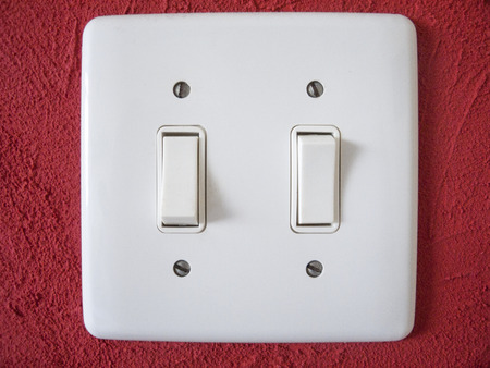 infra: Wallplate on red wall
