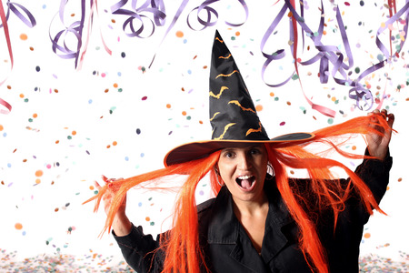 bewitch: Witch at Carnival. Wrong party time or just a costume? Stock Photo